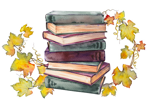 Stack of old books with grape leaf wreath.