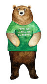 """Standing brown bear character wearing green colored human t-shirt with funny quote """"Feed Me and Tell Me I'm Pretty""""."""