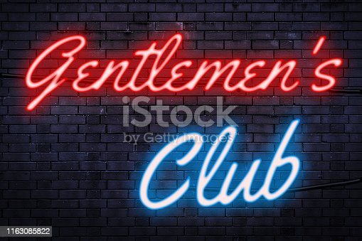 Strip club, striptease and nightlife concept theme with a red and blue light neon sign against a brick wall with the text gentlemen's club