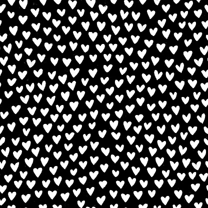 Stylish and original small uneven messy imperfect woolly white hearts shapes on black background - semaless modern minimalistic printing on the fabric