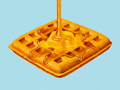 Syrup Being Poured on Waffle