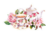 Tea cup and tea pot with flowers. Vintage card. Watercolor