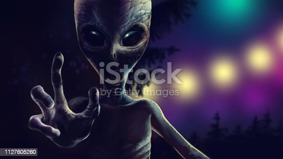 Scary alien is reaching out hand with four fingers to grab you. At night reptiloid on background of trees and lights from spaceship. Realistic portrait martian with dramatic lighting. 2d illustration.