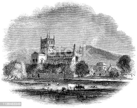 Abbey Church of St Mary the Virgin (Tewkesbury Abbey) at the town of Tewkesbury in Gloucestershire, England (circa 15th century) from the Works of William Shakespeare. Vintage etching circa mid 19th century.