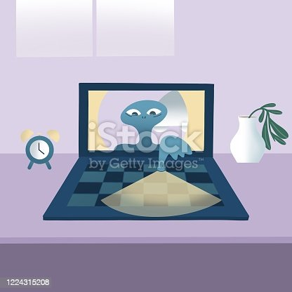 istock The Alien comes from a laptop at home 1224315208
