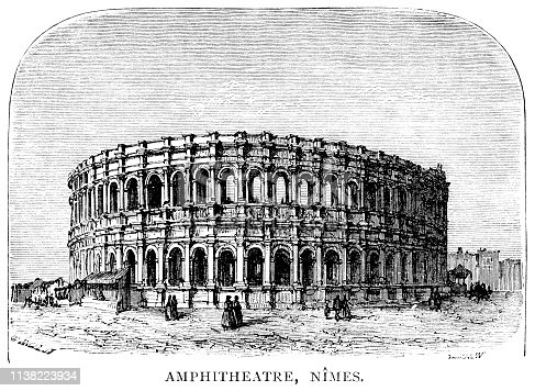 """The Arena of Nîmes in the Occitanie region of France, which was built cAD70 and was remodelled to serve as a bullfight ring in 1863. From """"French Pictures: Drawn With Pen and Pencil"""" by the Rev. Samuel G. Green, D.D. Published by The Religious Tract Society, London, 1878."""
