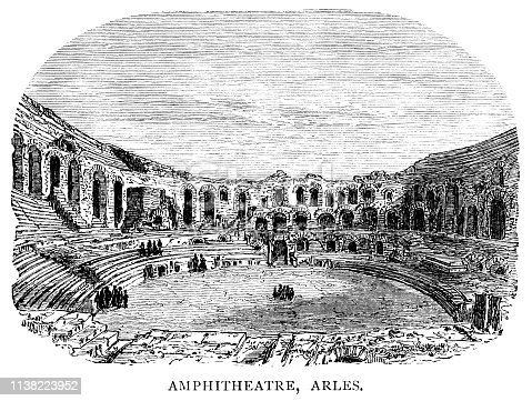"""The Arles Amphitheatre in Arles, a town in Bouches-du-Rhône, southern France, which dates from cAD90 and could seat over 20,000 spectators. Today it is used for bull fights. From """"French Pictures: Drawn With Pen and Pencil"""" by the Rev. Samuel G. Green, D.D. Published by The Religious Tract Society, London, 1878."""