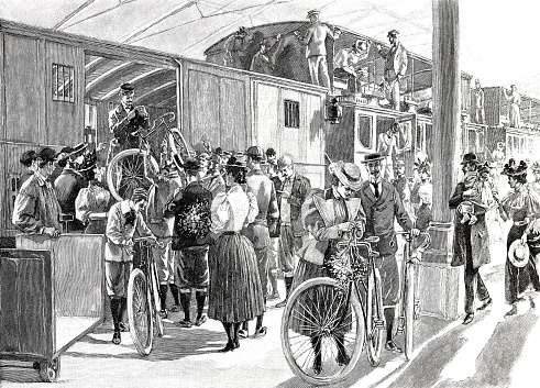 The crowd comes to remove the bicycles from the railroad car