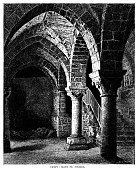 "Part of the crypt in the abbey of Le Mont-Saint-Michel, a small fortified island situated at the end of a causeway (now a bridge) off the coast of Normandy, France. It is a UNESCO World Heritage Site and is currently occupied by nuns and monks of the Monastic Fraternities of Jerusalem. From ""French Pictures: Drawn With Pen and Pencil"" by the Rev. Samuel G. Green, D.D. Published by The Religious Tract Society, London, 1878."