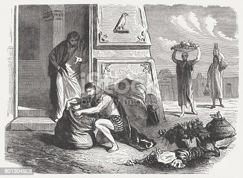 The silver cup is placed in Benjamin's sack (Genesis 44, 2). Wood engraving, published in 1886.