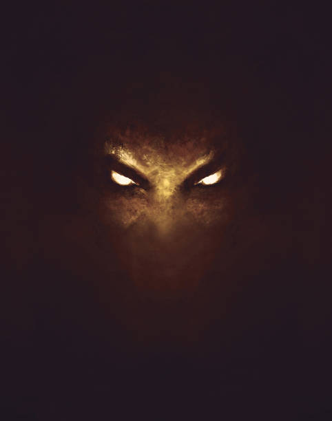 the face of a demon with glowing eyes vector art illustration
