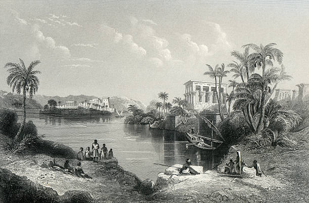 The Islands of Philae An engraving of Philae showing Trajan's Kiosk (right) and the Temple of Isis (left) in their original locations. Following the construction of the Old Aswan Dam in 1902, the temple complex was moved to Agilkia Island to protect it against flooding.  ancient egyptian culture stock illustrations