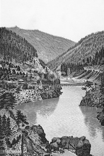 The original Alexandra Bridge at Fraser Canyon in the Canadian Rockies of British Columbia, Canada. Vintage etching circa late 19th century. The bridge was Destroyed by flood in 1894.