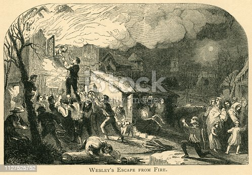 """Engraving taken from a painting by Henry Perlee Parker of the dramatic fire at Epworth Rectory where John Wesley, at that time a five-year-old boy, was rescued from the blaze through an upper floor window. Wesley (1703-1791) went on to co-found the Methodist movement with his brother Samuel. From """"The Juvenile Instructor: Vol XLII-Vol XII New Series"""" published by JC Watts in London, 1891."""