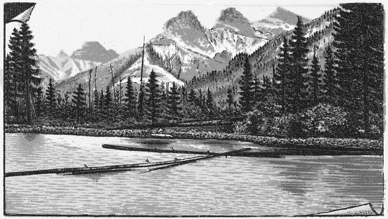 The Three Sisters mountains in the Canadian Rockies of Alberta, Canada. Vintage etching circa late 19th century. Alberta became a province in 1905, until then it was part of the Northwest Territories.