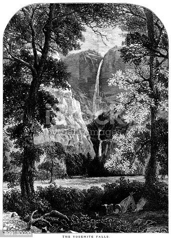 A man camping at the foot of the Yosemite Falls in Yosemite National Park, California.