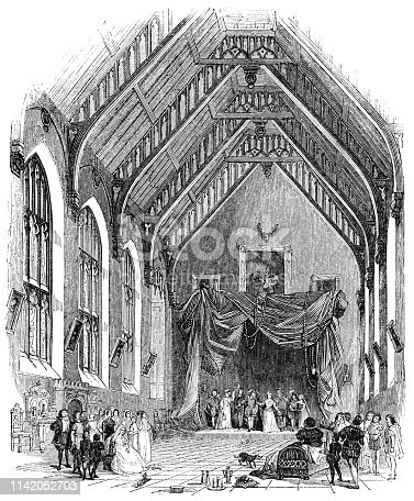 A theatre company performing at a country hall in a town in rural England (circa 16th century) from the Works of William Shakespeare. Vintage etching circa mid 19th century.
