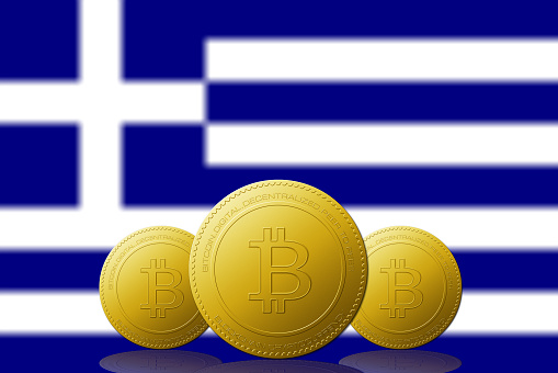 Three Bitcoins cryptocurrency with Grecia flag on background.