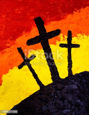 Three Crosses silhouettes against red orange yellow background