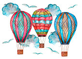 Three watercolor cartoon multicolored balloons flying among clouds and birds isolated on white background