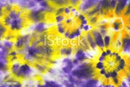 Tie dye shibori colorful pattern. Watercolor hand painted purple and yellow colored elements on white background. Watercolour abstract texture. Print for textile, fabric.