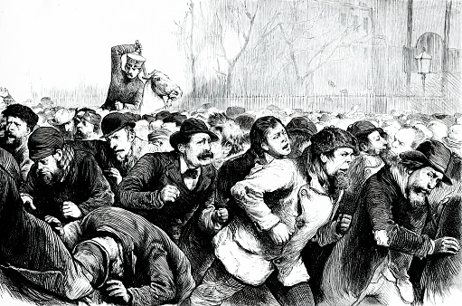 Vintage engraving features The Tompkins Square Riot of 1874. Thousands of unemployed workers gathered at the park to protest the poor economic conditions brought on by the Panic of 1873. Police on horseback fought back the crowds by beating them with clubs.