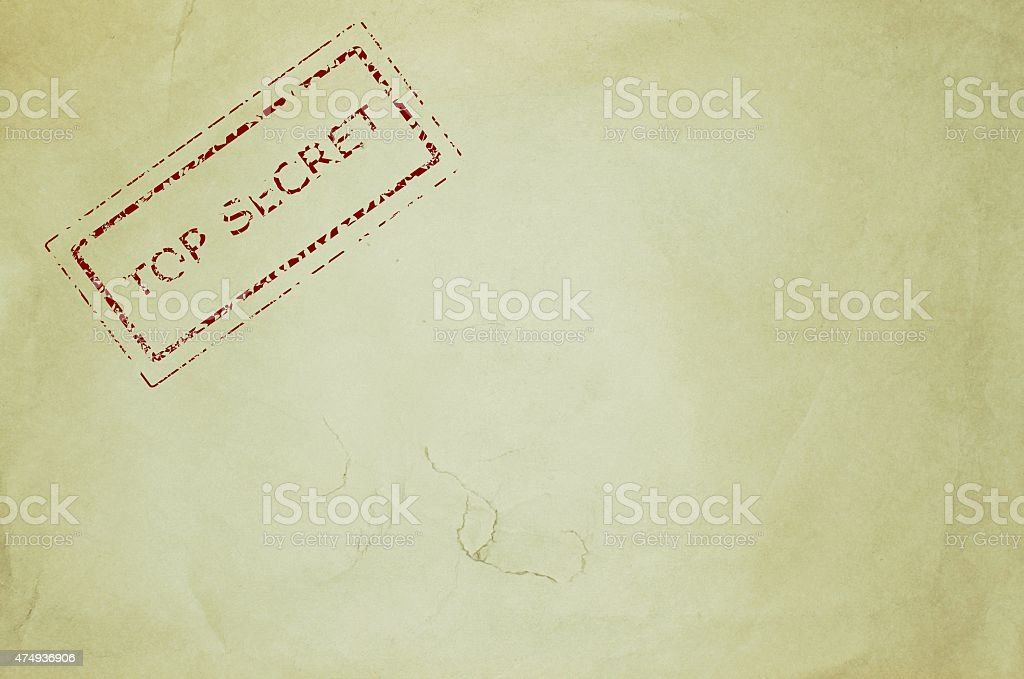 Top secret rubber stamp on an old piece of paper vector art illustration