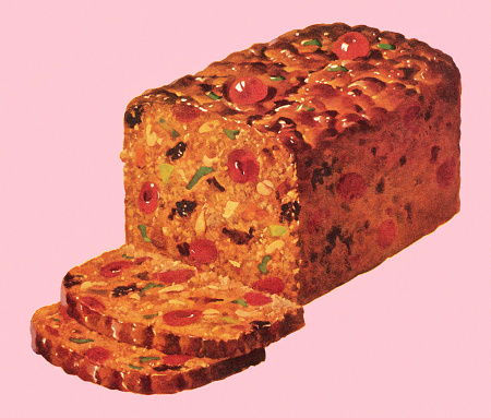 Traditional fruitcake with slices set on a pink background