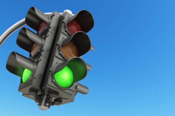 traffic light with green color on blue sky background. - stoplights stock illustrations, clip art, cartoons, & icons