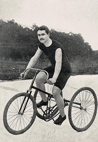 Tricyclist B.W. Crump in a velodrome