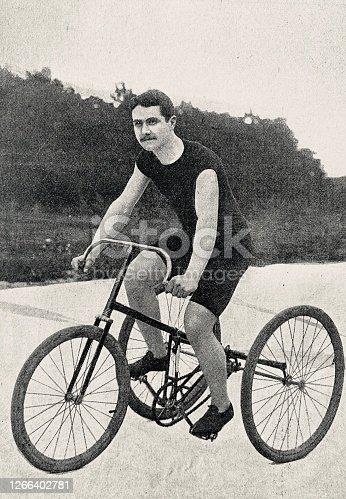 istock Tricyclist B.W. Crump in a velodrome 1266402781