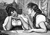 Two girl friends at the table, reading a letter and discussing