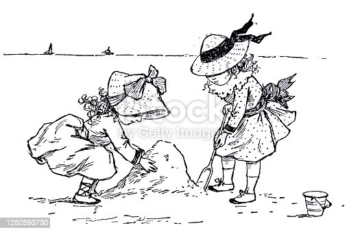 istock Two girls build a sandcastle on the beach 1252593730