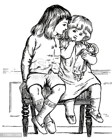 Two girls sitting on a chair with puppet, front view