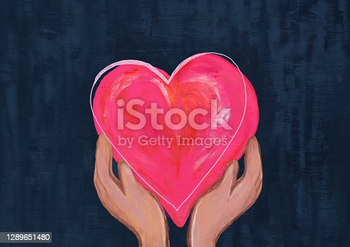 istock Two hands holding pink and red heart. concept of love and care. 1289651480