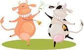 Two happy  dancing cows