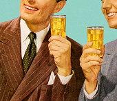 istock Two Men Holding Drinks 152406377