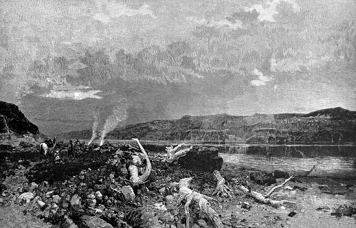 Two men in turbans on their heads take a break on the banks of the river and burn a bonfire - 1888