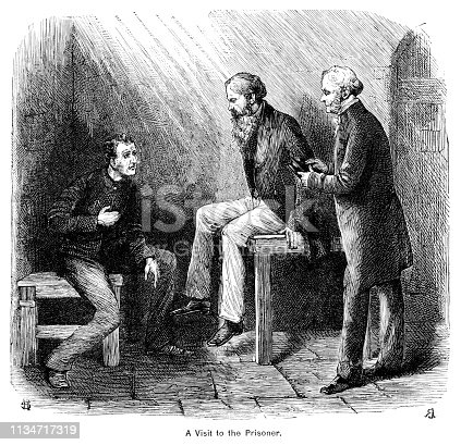"""Two men visiting a prisoner in a dark Victorian gaol. One of them appears to be a clergyman holding a bible, so the prisoner could be in the condemned cell and about to depart for the gallows. From """"The Cottager and Artisan 1890"""". Published by The Religious Tract Society, London."""