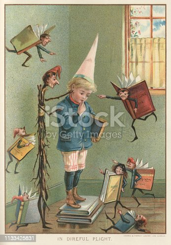"""A Victorian schoolboy wearing a dunce's cap is standing in the corner on a pile of books. Fluttering around him are fantastical images of more schoolbooks who are taunting him about his stupidity and failure. There is also a besom tweaking his ear, to remind him that he needs chastisement. From """"Little Folks - A Magazine for the Young"""" published in 1894 by Cassell & Company Ltd., London, Paris and Melbourne."""