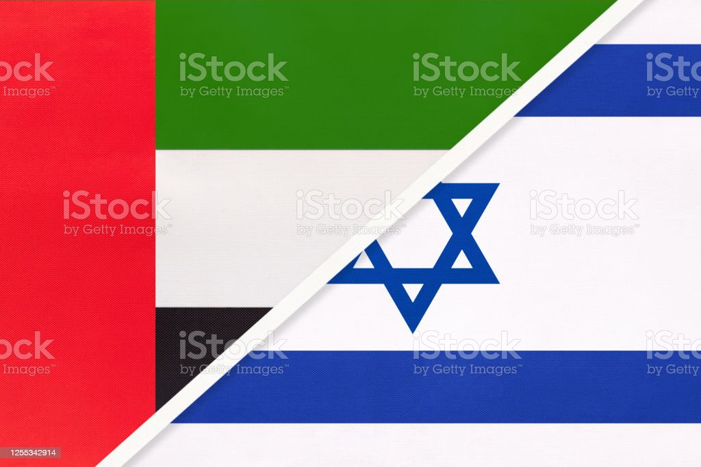 United Arab Emirates or UAE and Israel, symbol of national flags from textile. Championship between two countries. - Zbiór ilustracji royalty-free (Azja)