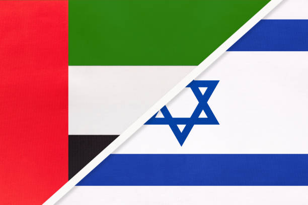 united arab emirates or uae and israel, symbol of national flags from textile. championship between two countries. - uae flag stock illustrations