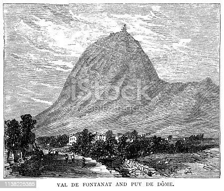"View from the Val de Fontanat to the Puy de Dôme, a lava dome and dormant volcano in the Chaîne des Puys in the Auvergne, France. In 1876, a meteorogical laboratory was built on the summit and an observatory still exists there. From ""French Pictures: Drawn With Pen and Pencil"" by the Rev. Samuel G. Green, D.D. Published by The Religious Tract Society, London, 1878."