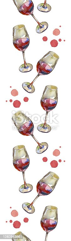 istock Vertical seamless border of wineglasses with red wine and wine droplets, isolated on white. Watercolor illustration. 1282543861
