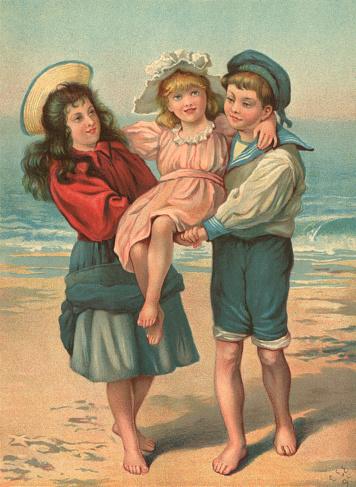 Victorian children playing on a beach
