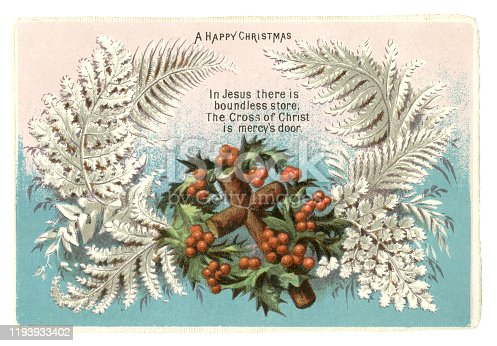 "A Victorian Christmas card from 1874 showing a wooden cross surrounded by holly leaves and berries with silver coloured ferns. A verse proclaims, ""In Jesus there is boundless store, The Cross of Christ is mercy's door""."