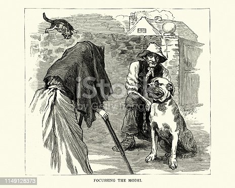 istock Victorian female photographer taking photograph of man and dog 1149128373
