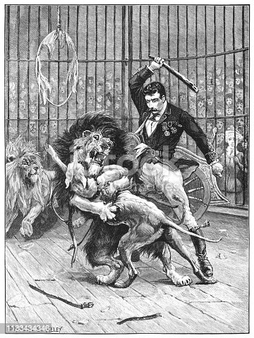 "During a 19th century circus performance, a lion-tamer is attempting to separate a lion and a dog who are fighting, apparently to the death. Another lion nearby appears to be about to join in and the situation is becoming dangerous, to the horror of the spectators. From ""Little Folks - A Magazine for the Young"" published in 1894 by Cassell & Company Ltd., London, Paris and Melbourne."