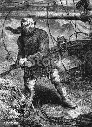 istock Victorian sailor at the tiller of a sailing ship in a storm 1213523452