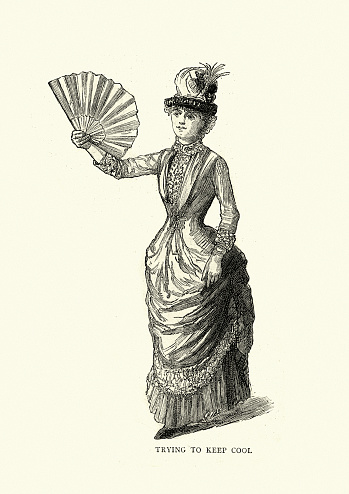 Victorian woman trying to keep cool with a hand fan